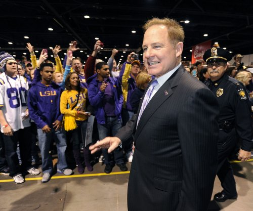 LSU coach Les Miles visits hospital, returns for practice