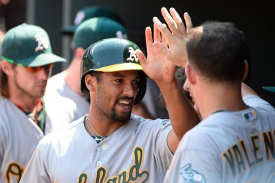 Marcus Semien, Jake Smolinski homers send Oakland Athletics past Cincinnati Reds