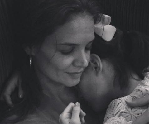 Katie Holmes cuddles daughter Suri Cruise in new photos
