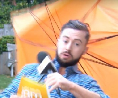 Irish weatherman nearly blown away by strong gust of wind