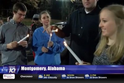 Community holds candlelight vigil for Taco Bell destroyed by fire