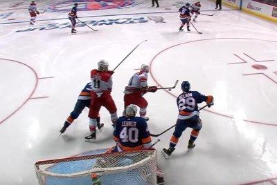 Carolina Hurricanes score two goals in 48 seconds to beat New York Islanders