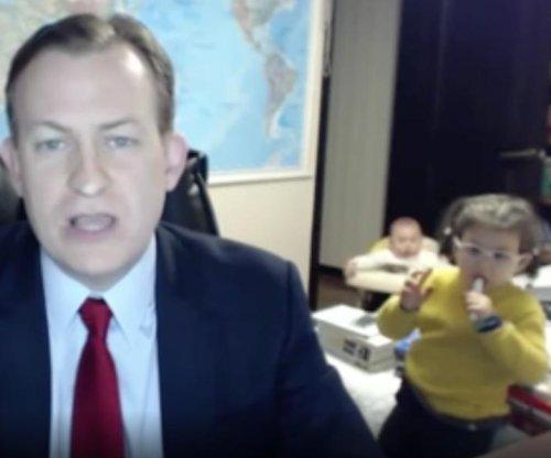 Curious children videobomb father's BBC news interview