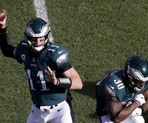 Philadelphia Eagles overcome Los Angeles Rams, injury to Carson Wentz