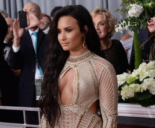 Demi Lovato, Carrie Underwood wear flirty looks to Grammys