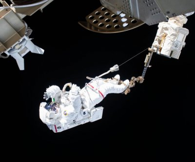 Spacewalkers back inside ISS after completing work to repair particle detector