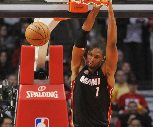 Heat's Chris Bosh stays in Miami