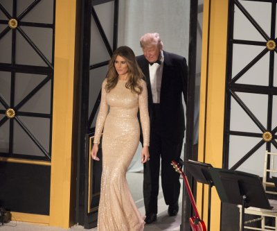 Melania Trump wears gold Reem Acra gown at pre-inauguration dinner