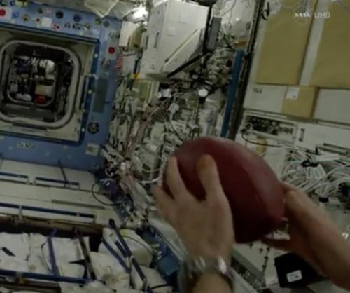 ISS astronaut throws longest ever football pass (well, sort of)