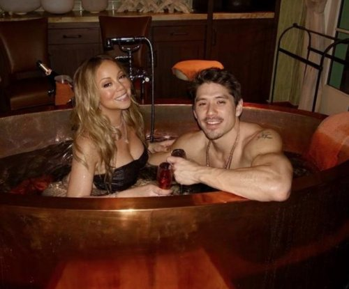Mariah Carey gets close to Bryan Tanaka on Valentine's Day