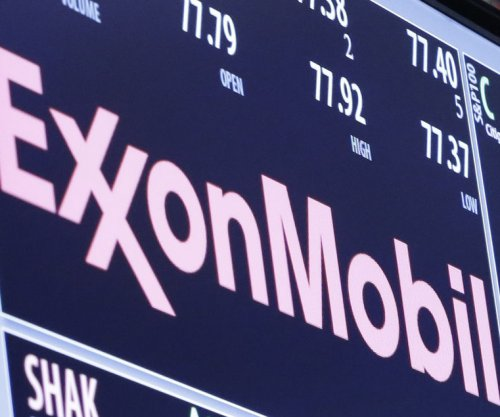 Exxon earning and spending more