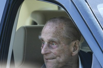 Britain's Prince Philip won't be charged in crash after surrendering license