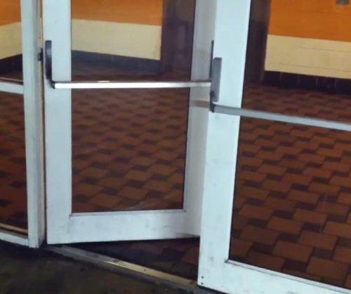 Chicago parking garage door does Miles Davis 'impression'