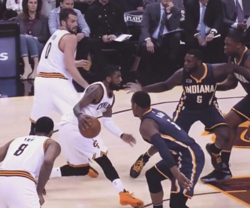 Kyrie Irving nearly makes Lance Stephenson face-plant with crossover