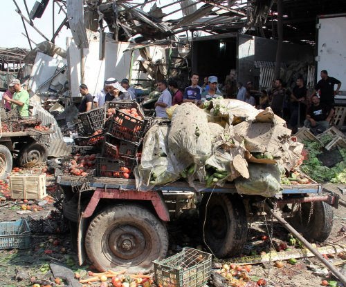 Car bomb kills 64 in Baghdad Shiite district
