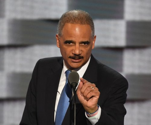 Former U.S. AG Holder hired to help California fend off Trump White House