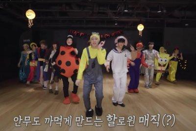 Treasure wears Halloween costumes in 'Mmm' dance performance video