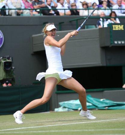 Sharapova advances to fourth round