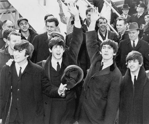 Early John Lennon guitar sells for $2.4 million