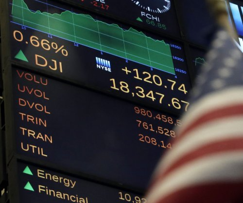 Dow, S&P 500 close at new record highs; Nasdaq wipes out losses for '16
