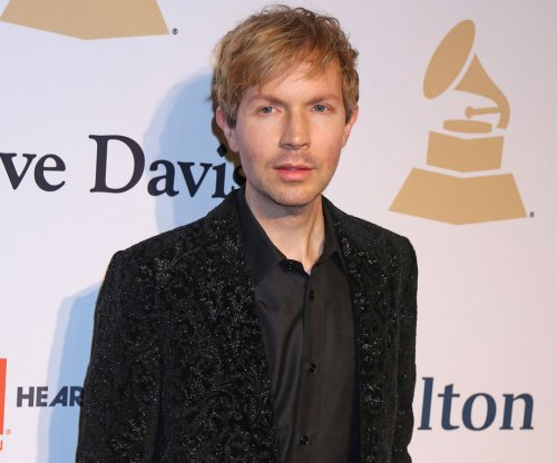 Beck says Kanye West 'deserves to be onstage'