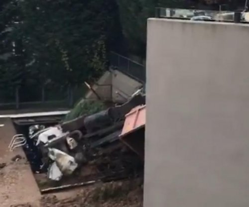 Dump truck falls into Evan Turner's pool