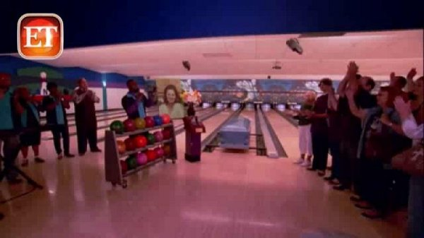 family of bowler pushes casket down the lane during
