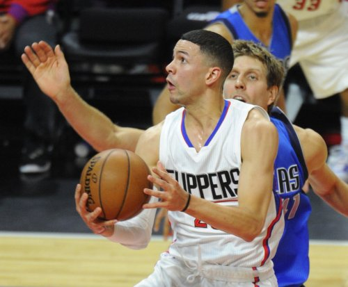 Austin Rivers, Wesley Johnson remain with Los Angeles Clippers