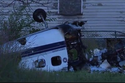 2 dead after plane crashes on street near Detroit airport