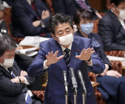 Japan's Shinzo Abe says he has no intention to leave office