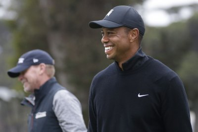 Tiger Woods 'recovering, in good spirits' after follow-up procedures