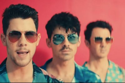 The Jonas Brothers have an old school beach party in 'Cool' video