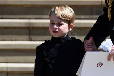 Prince George smiles for the camera on 7th birthday