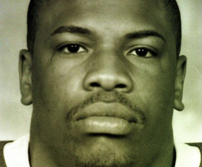Ex-NFL RB Lawrence Phillips charged with killing cellmate