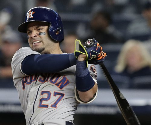 Jose Altuve sparks Houston Astros' ninth inning rally over Kansas City Royals