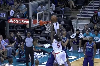 Hornets' Miles Bridges palms Montrezl Harrell dunk attempt on nasty block