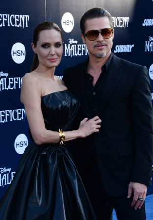 Brad Pitt talks meeting the queen, Angelina Jolie's new rank as dame