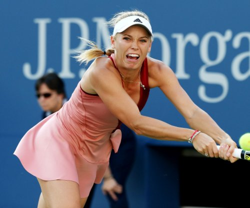 Kvitova, Wozniacki advance; Halep, Bouchard vanquished at Big W