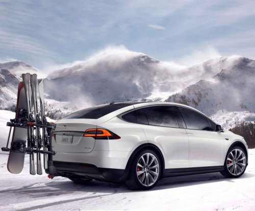 Tesla unveils 250-mile range, $130,000 Model X crossover