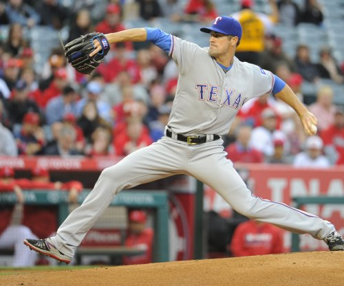 Cole Hamels pitches Texas Rangers past Seattle Mariners