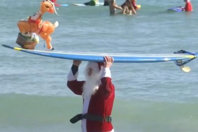 Hundreds of surfing Santas ride the waves in Florida