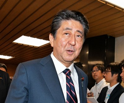 Shinzo Abe becomes longest-serving Japanese prime minister