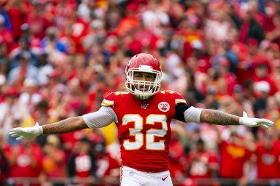 Chiefs use defense to rally past Broncos, clinch playoff spot