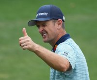 Masters: Justin Rose enters weekend with one-shot lead at Augusta