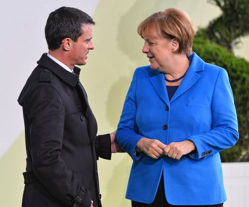 Merkel under pressure to tamp down on refugees