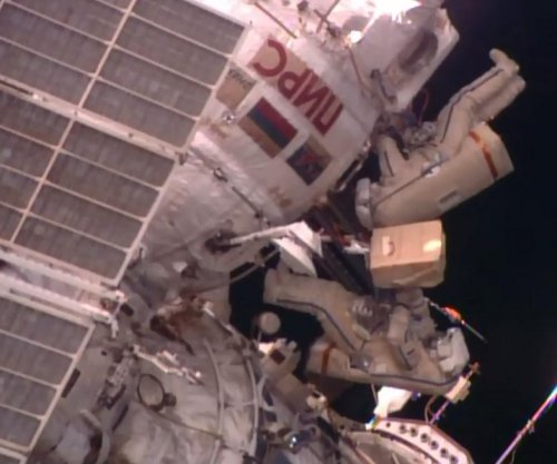 Russians spacewalk to retrieve biological samples