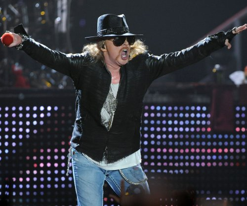 Guns N' Roses invite fans onstage to attack Donald Trump pinata in Mexico