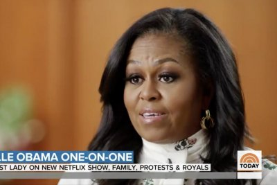 Michelle Obama hopes for 'forgiveness and healing' for royal family