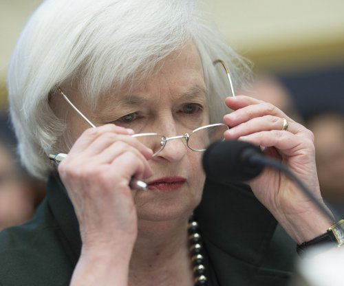 Fed keeps interest rates unchanged for 82nd straight month, cites 'downward pressure' on inflation