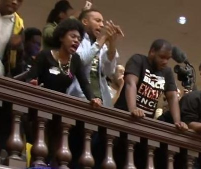 Protests resume at Baltimore City Hall after 16 arrested, jailed for trespassing